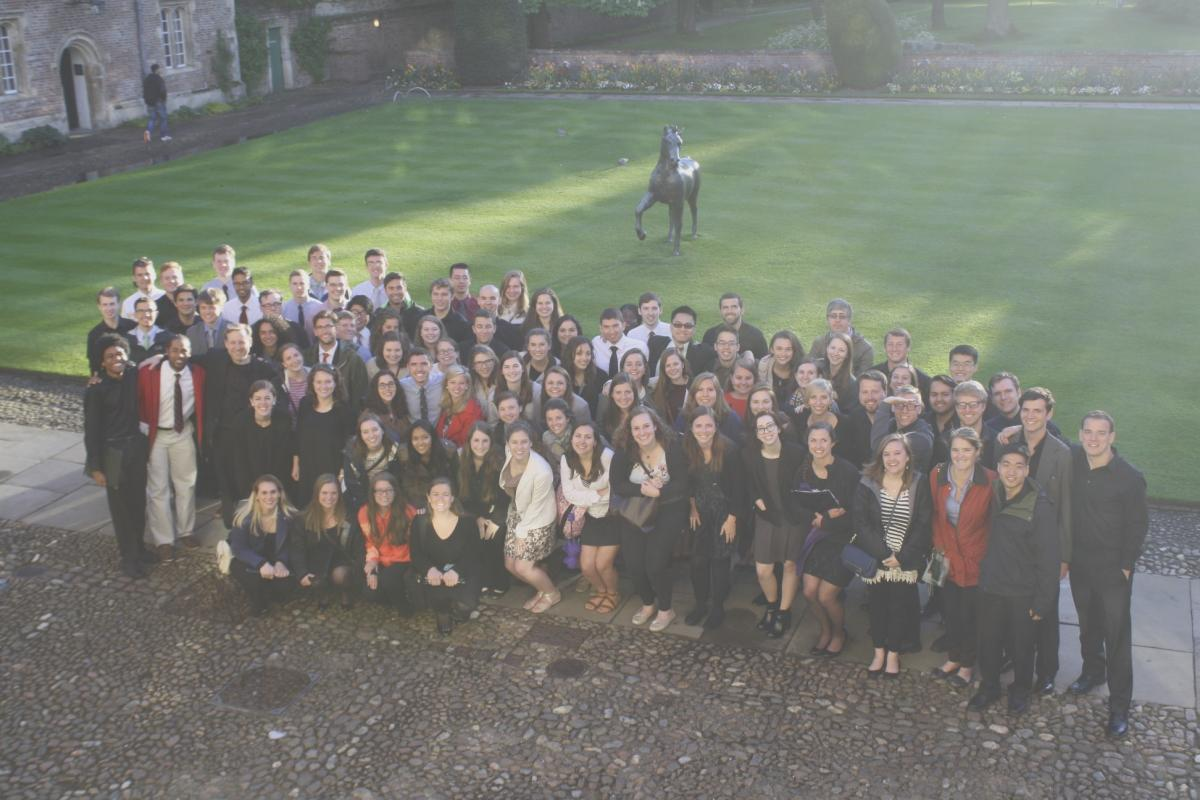The University Singers pose outside Jesus College in Cambridge after Evensong.